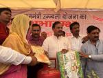 Hon'ble MoS(I/C) Culture & Tourism & Aviation distributing LPG connections to women under BPL under PMUjjwalaYojana in Noida on 14th June'16.