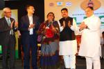 Hon'ble Health Minister and Hon'ble MoS(I/C) PNG Felicitating PMUjjwalaYojana beneficiaries at the International LPG conference at Bhubaneswar on 02nd Sep'16