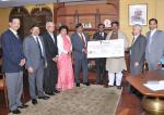 Hon'ble MoS(I/C) PNG Receiving dividend cheque of 3rd quarter for the FY 2015-16 from Shri U.P. Singh, CMD, OIL and Addl. Secy., MoPNG at Shastri Bhawan on 17th Feb'16.