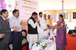 Hon'ble MoS(I/C) PNG during handing over keys of toilets constructed by ONGC MRPL under Swachh Bharat Abhiyan to School Management at Mangaluru on 5th Apr'15.