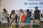Hon'ble Prime Minister Shri Narendra Modi Ji giving LPG Connections to BPL Families under 'Give Back' Scheme at Dumka on 02nd Oct'15.