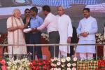 Hon'ble PM distributing aid appliances such as hearing aid to Divyangs after the dedication of Paradip Refinery to the Nation on 7th Feb'16.