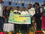 Hon'ble Union Minister of P&NG and SD&E handing over the Prize to the winner of Elite Race (Male category) in Saksham Cyclothon event organized by PCRA at Kalinga stadium, Bhubaneshwar on 4th Feb'18