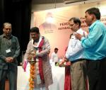 Shri Dharmendra Pradhan lighting the lamp June,03-2017